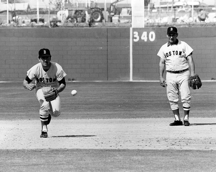 Rico Petrocelli takes infield practice at third base during spring training as Frank Malzone looks on. (Photo by Boston Red Sox)